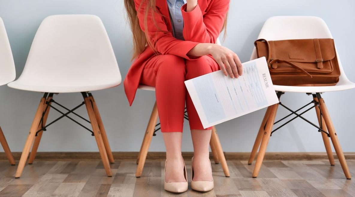 woman holding a resume